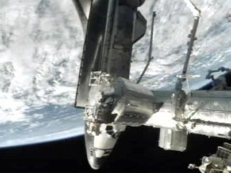 Associated Press This frame grab from NASA-TV shows space shuttle Atlantis docked at the International Space Station on Sunday. Atlantis' current supply visit marks the final shuttle mission by NASA.
