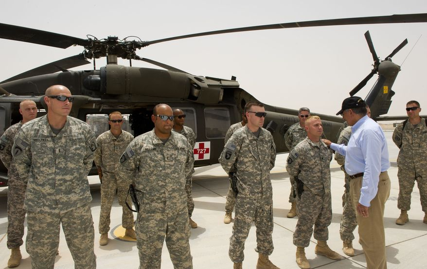 Defense Secretary Leon E. Panetta greets members of the helicopter medivac crew attached to the 115th Combat Support Hospital while making an unannounced visit to Camp Dwyer in southern Afghanistan on Sunday, July 10, 2011. (AP Photo/Paul J. Richards, Pool)