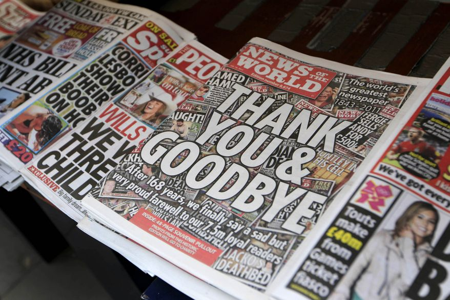 The last edition of the 168-year-old News of the World is displayed at a newsstand in central London on Sunday, July 10, 2011. (AP Photo/Sang Tan)