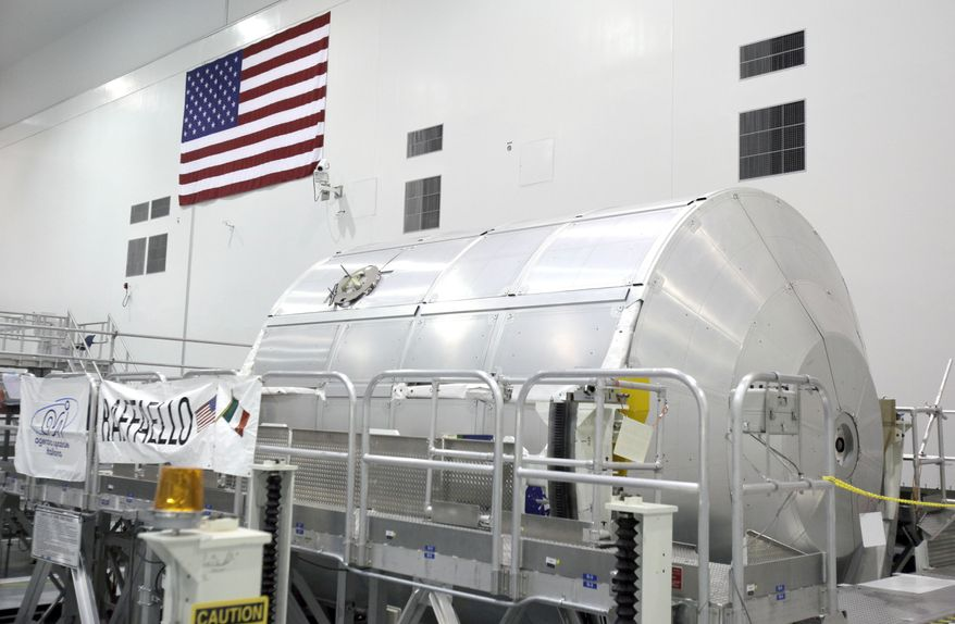 """** FILE ** A payload canister named """"Raffello,"""" seen here in early June at the Space Station Processing Facility at the Kennedy Space Center in Cape Canaveral, Fla., is on board the space shuttle Atlantis with a cargo of supplies. (AP Photo/John Raoux)"""