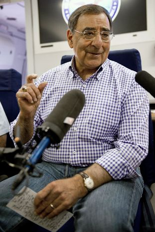 Defense Secretary Leon E. Panetta conducts a press briefing aboard his military aircraft on Saturday, July 9, 2011, en route to Kabul, Afghanistan. (AP Photo/Paul J. Richards, Pool)
