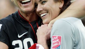 Abby Wambach (left) and Hope Solo had plenty of reason to smile after the U.S. defeated Brazil in the quarterfinals Sunday. (Associated Press)