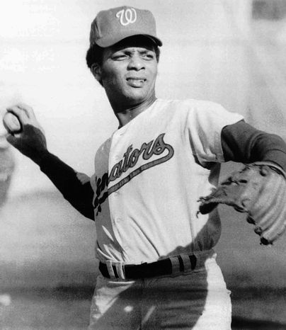 Curt Flood made three All-Star appearances the 1960s. He played 13 games for the Washington Senators in 1971 before retiring. (Associated Press)