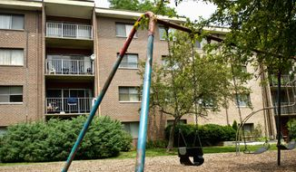 ** File ** A playground at Grand Bel Manor Apartments in Olney, Maryland. (Drew Angerer/The Washington Times)
