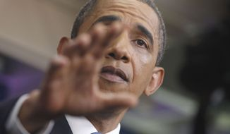 President Obama talks about the ongoing budget negotiations on July 11, 2011, in the briefing room of the White House. (Associated Press)