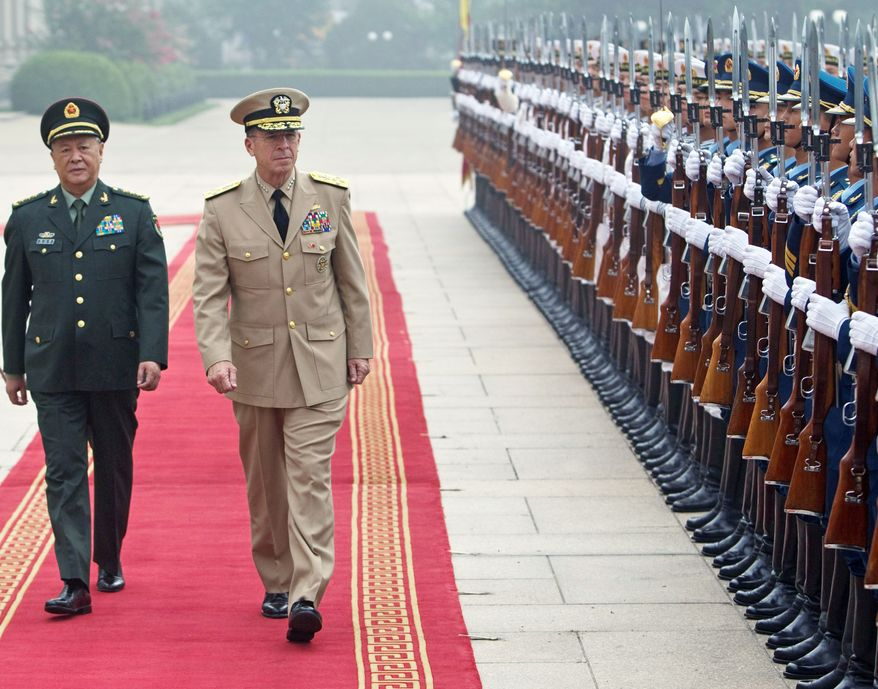 ** FILE ** Chinese Gen. Chen Bingde (left) and U.S. Navy Adm. Mike Mullen, chairman of the Joint Chiefs of Staff, review an honor guard during a welcoming ceremony for Adm. Mullen at the Bayi Building in Beijing on Monday, July 11, 2011. (Associated Press)