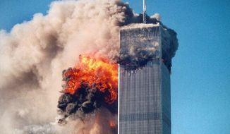 This photo by Roberto Robanne shows the impact of one of the airplanes hitting the World Trade Center in New York City on Sept. 11, 2001.