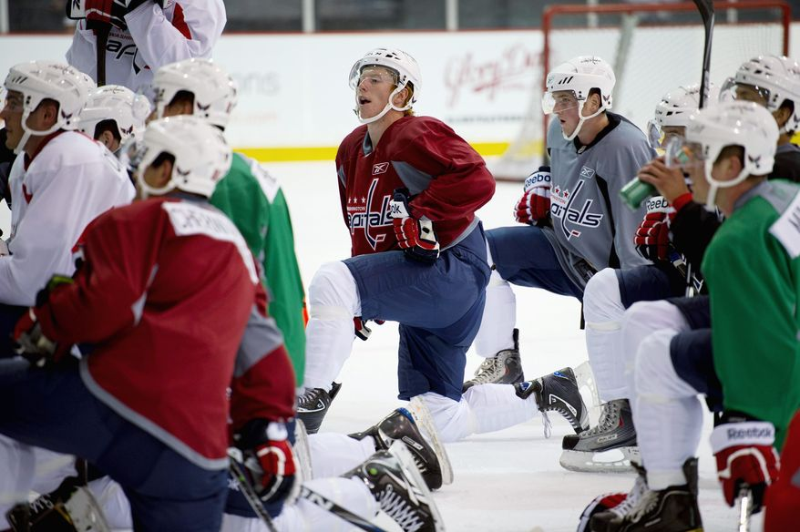 Rod Lamkey Jr./The Washington Times Prospect Cody Eakins (center) is trying to make the Capitals' roster in his second season with the organization.