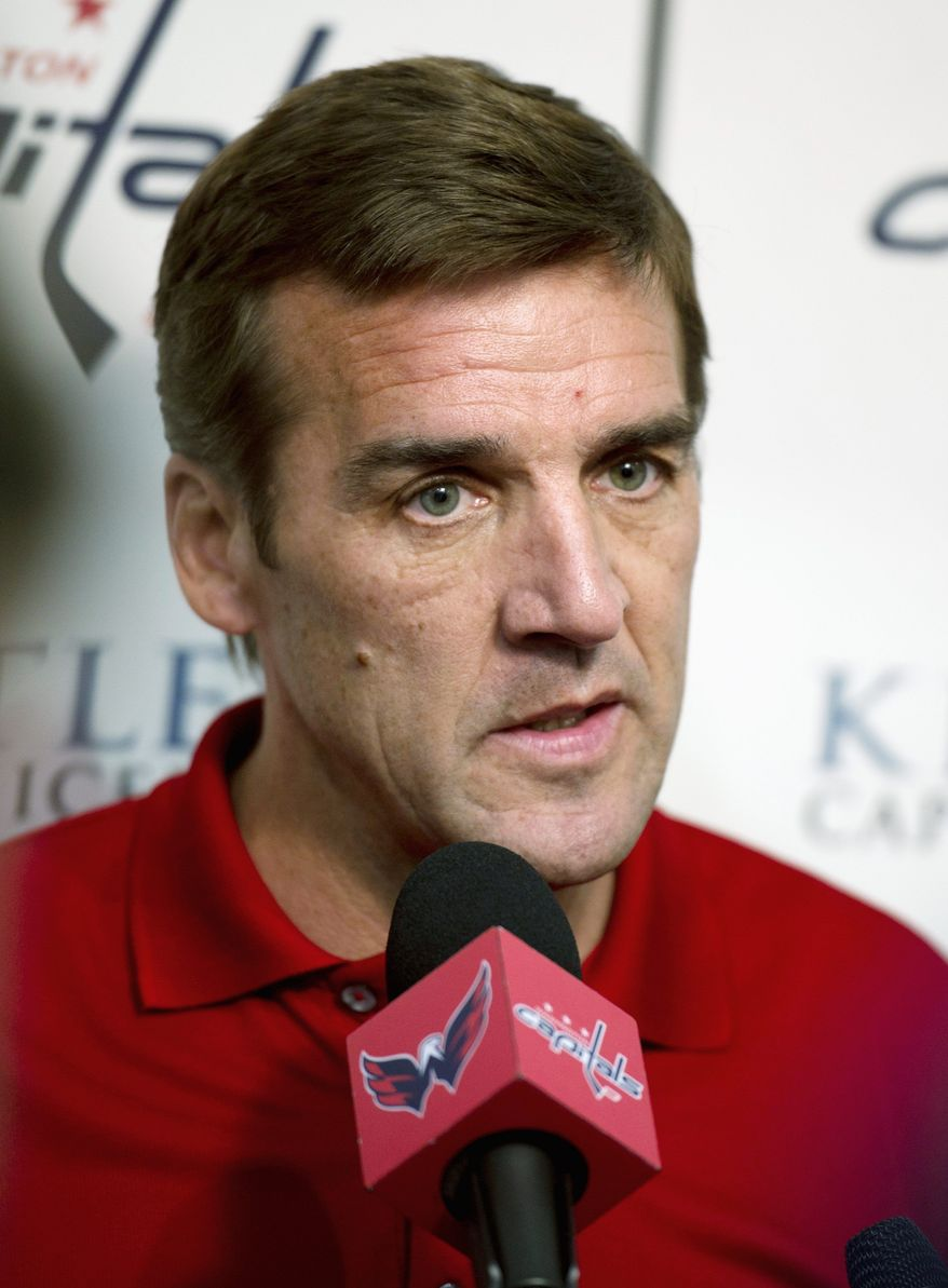 Washington Capitals General manager George McPhee talks with reporters during a press conference at the Kettler Capitals Iceplex in Arlington, Va., Monday, July 11, 2011. (Rod Lamkey Jr/The Washington Times)