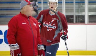 ROD LAMKEY JR./THE WASHINGTON TIMES Cody Eakin, shown with coach Bruce Boudreau at Kettler Capitals Iceplex, scored 36 goals and collected 47 assists in 56 games last season in the Western Hockey League.