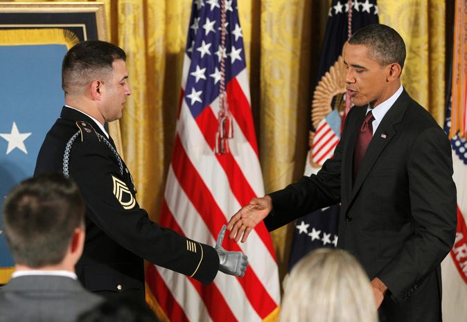ASSOCIATED PRESS President Obama greets Sgt. 1st Class Leroy Arthur Petry before awarding him the Medal of Honor during a ceremony in the East Room of the White House on Tuesday. Sgt. Petry is the ninth service member to have been named a recipient of the Medal of Honor for actions in Afghanistan and Iraq.