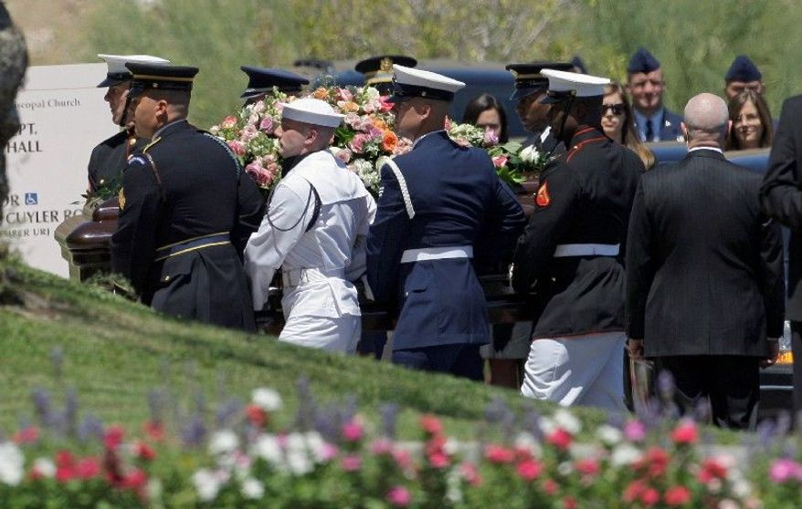 ASSOCIATED PRESS A military honor guard carries the casket of former first lady Betty Ford to a funeral service Tuesday at St. Margaret's Episcopal Church in Palm Desert, Calif. First lady Michelle Obama and former President George W. Bush were among those in attendance. Mrs. Ford died Friday at age 93.