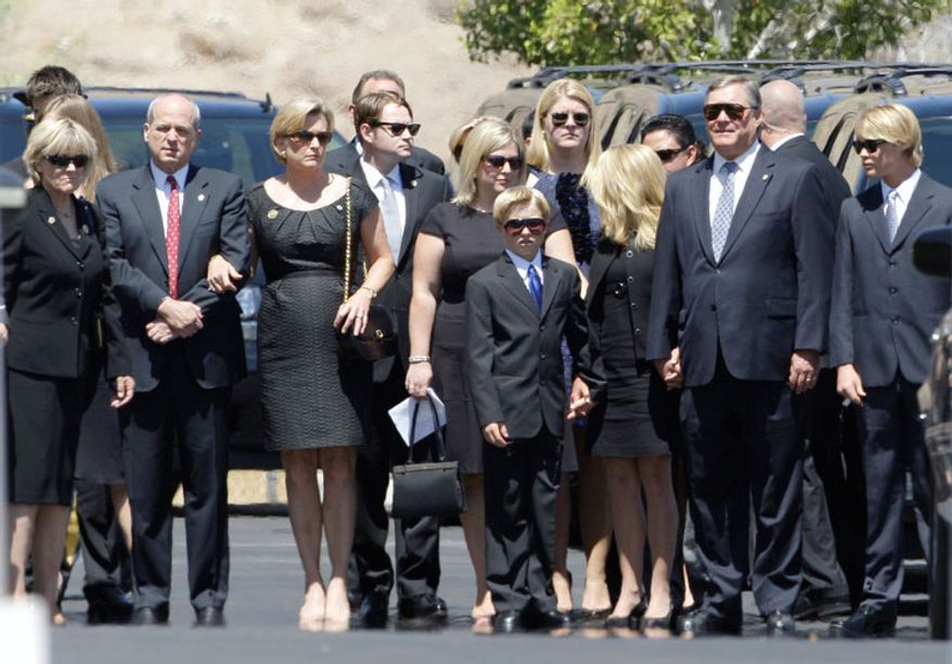 Ford family members prepare to enter the funeral of former first lady Betty Ford. (AP Photo/Reed Saxon)