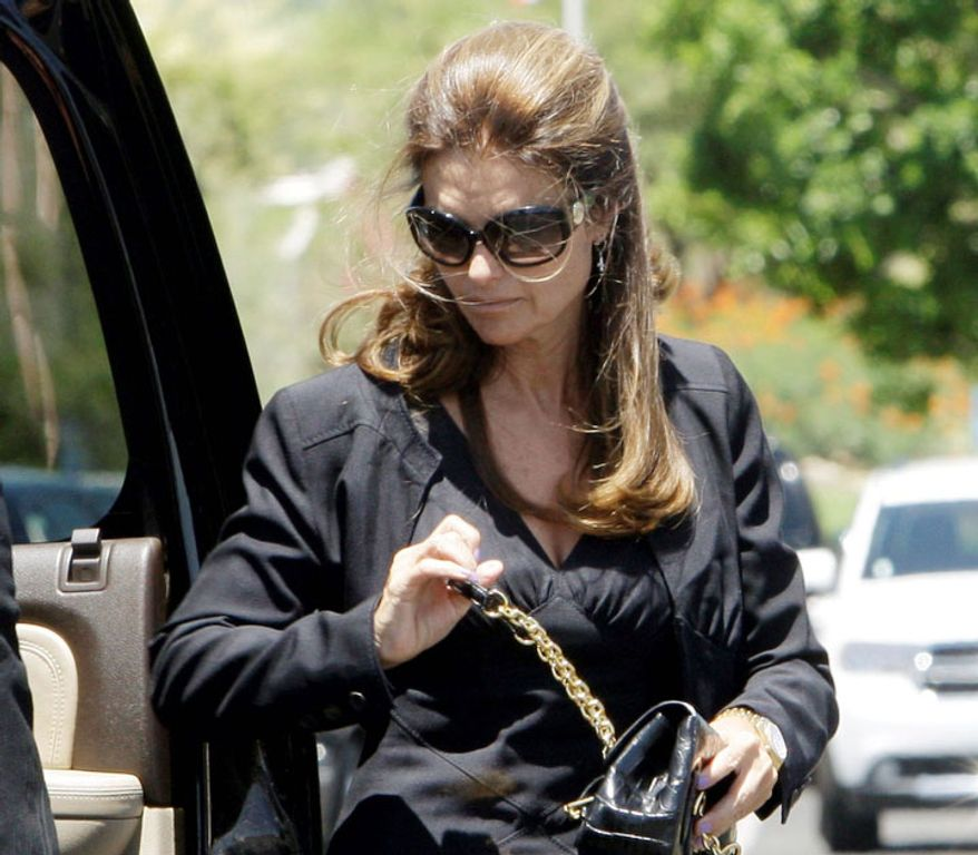 Maria Shriver arrives at the funeral of former first lady Betty Ford on Tuesday, July 12, 2011. (AP Photo/Reed Saxon, Pool)