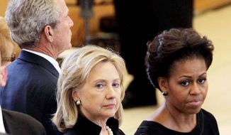 ** FILE ** Secretary of State Hillary Rodham Clinton, center, and first lady Michelle Obama stand together during the funeral for former first lady Betty Ford at St. Margaret's Episcopal Church Tuesday, July 12, 2011, in Palm Desert, Calif. Former President George W. Bush is at back. (AP Photo/Jae C. Hong, Pool)