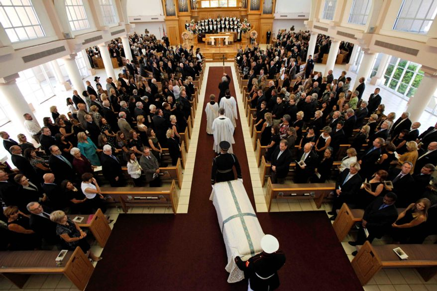The casket bearing the body of former first lady Betty Ford is carried by members of the armed forces into St. Margaret's Episcopal Church Tuesday, July 12, 2011, in Palm Desert, Calif.  (AP Photo/Jae C. Hong, Pool)