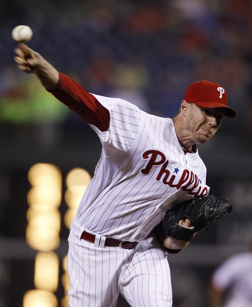 Philadelphia Phillies starting pitcher Roy Halladay is one of the many pitchers across baseball who has contributed to the decrease in scoring this year - a 6 percent dip at the midpoint as compared to last season. (AP Photo/Matt Slocum)