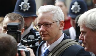 ** FILE ** WikiLeaks founder Julian Assange arrives at the High Court in London on Tuesday, July 12, 2011, for his extradition appeal hearing. (AP Photo/Lefteris Pitarakis)