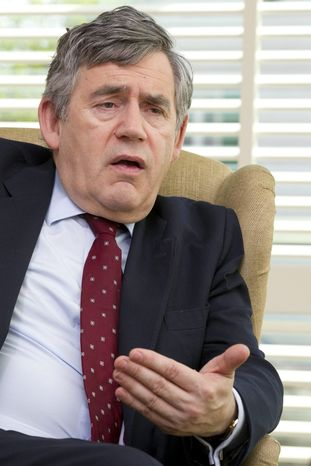 ** FILE ** In this Tuesday, April 5, 2011, file photo, former British Prime Minister Gordon Brown answers question during an interview with the Associated Press in Geneva, Switzerland. British media say that former Prime Minister Gordon Brown had his personal information targeted by elements of Rupert Murdoch's media empire. (AP Photo/Salvatore Di Nolfi, File)