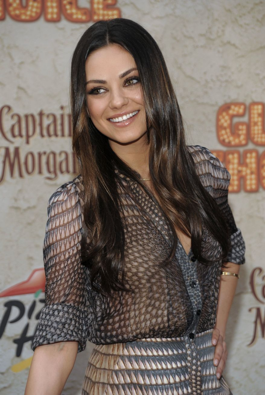 ** FILE ** In a June 4, 2011, file photo Mila Kunis arrives at the Spike TV Guys Choice Awards in Culver City, Calif. A Marine's YouTube request to go on a date with Kunis got through to the actress. (AP Photo/Dan Steinberg)