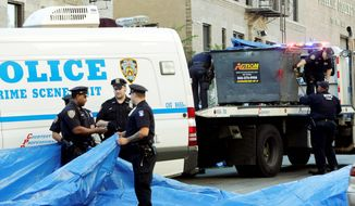 Police prepare to remove a dumpster thought to have held remains of Leiby Kletzy, an 8-year old Brooklyn boy who reportedly got lost walking home from day camp and was seen with a man, since arrested, on a surveillance video. (Associated Press)