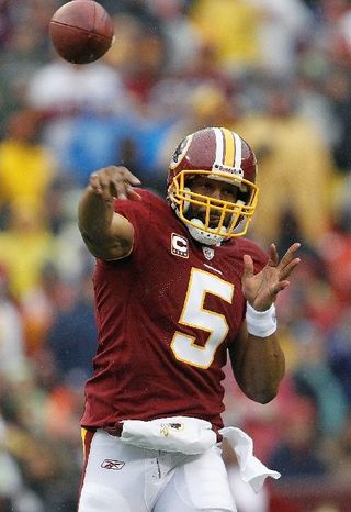 Washington Redskins quarterback Donovan McNabb passes during the first half of an NFL football game against the Tampa Bay Buccaneers in Landover, Md., Sunday, Dec. 12, 2010. (AP Photo/Evan Vucci)