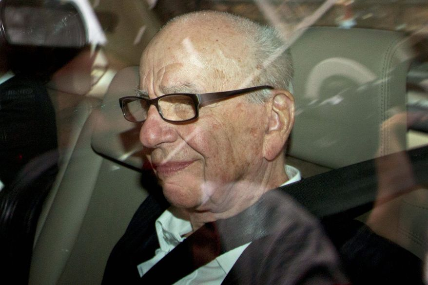 ASSOCIATED PRESS News Corp. Chairman Rupert Murdoch arrives home in London on Wednesday, the day it was announced that his company dropped its bid to buy controlling interest in British Sky Broadcasting (BSkyB).