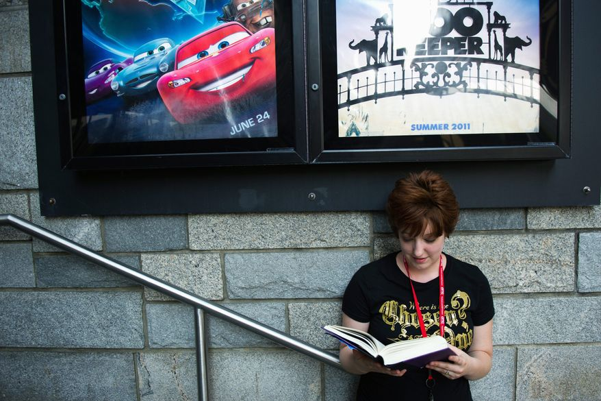 "DREW ANGERER / THE WASHINGTON TIMES ""There's just something about the relationship between Harry [and his best friends] Ron and Hermione that resonated with so many people,"" Bethesda resident Cat O'Dell said before going in to watch the Harry Potter marathon at the AMC Loews Georgetown. The final installment debuts Thursday night."
