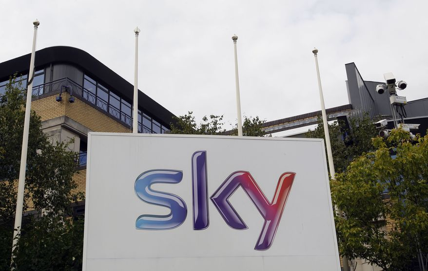 A Sky sign at the BSkyB offices in Isleworth in London is seen on July 13, 2011. (Associated Press)