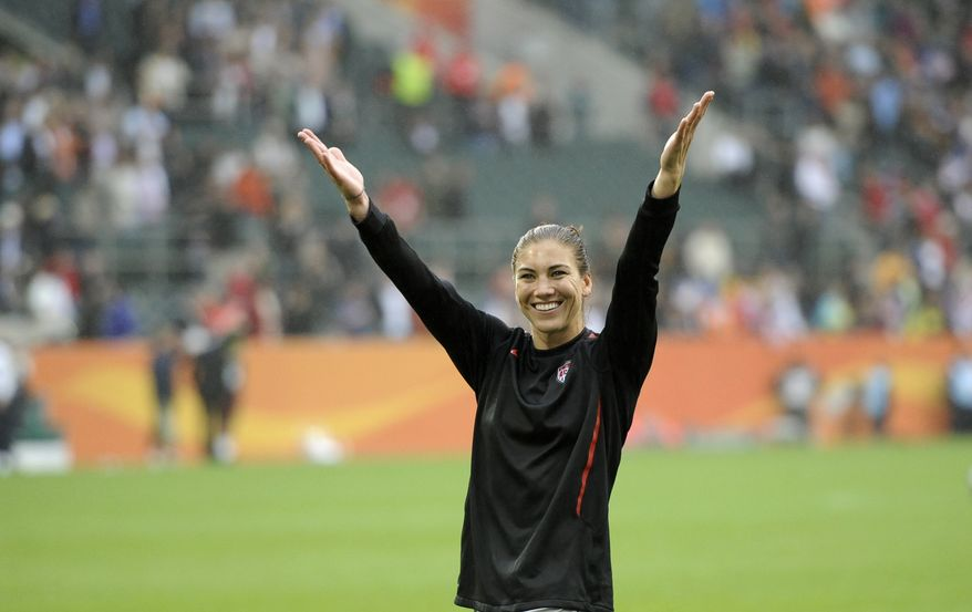 United States goalkeeper Hope Solo gestures after U.S. beat France 3-1 in the World Cup semifinal in Moenchengladbach, Germany on Wednesday, July 13, 2011. (AP Photo/Martin Meissner)