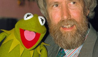 """** FILE ** In this February 1988 photo Jim Henson, creator of the Muppets, poses with one of his creations, Kermit the Frog. A touring exhibit, """"Jim Henson's Fantastic World,"""" opening Saturday, July 16, 2011, is making its last stop of a multi-year trip at the Museum of the Moving Image in Queens, New York where it will be on display into January. (AP Photo/file)"""