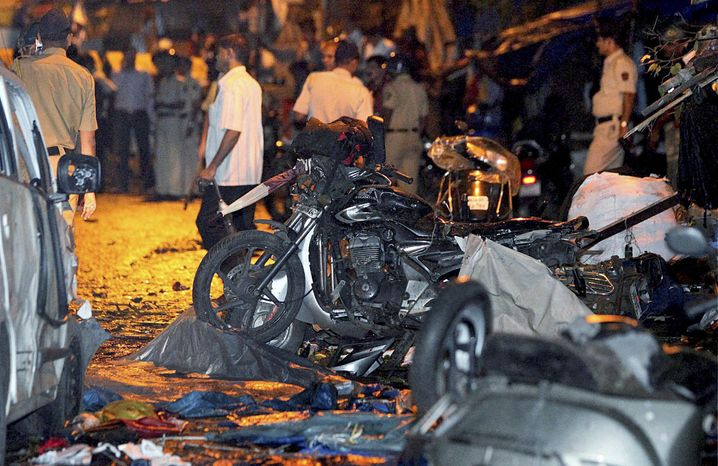 The wreckage of motorbikes lies at the site of a bomb blast outside the Opera House in Mumbai, India, on Wednesday, July 13, 2011. (AP Photo)