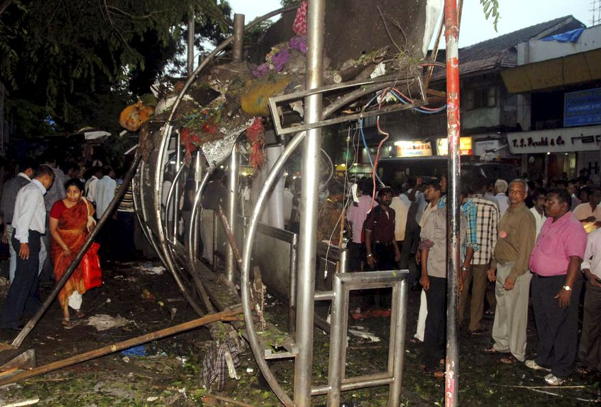 People gather at the site of an explosion at Dadar in Mumbai, India, on July 13, 2011. Three explosions rocked India's busy financial capital at rush hour in what officials described as another terror strike on the city hit by militants nearly three years ago. (Associated Press)