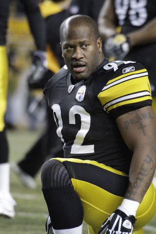"Pittsburgh Steelers linebacker James Harrison (92) warms up before an NFL football game against the Carolina Panthers in Pittsburgh, in this Dec. 23, 2010 file photo. Heavily fined Pittsburgh Steelers linebacker James Harrison calls NFL Commissioner Roger Goodell a ""crook"" and a ""devil,"" among other insults, in a magazine article in the August issue of Men's Journal. (AP Photo/Gene J. Puskar, File)"
