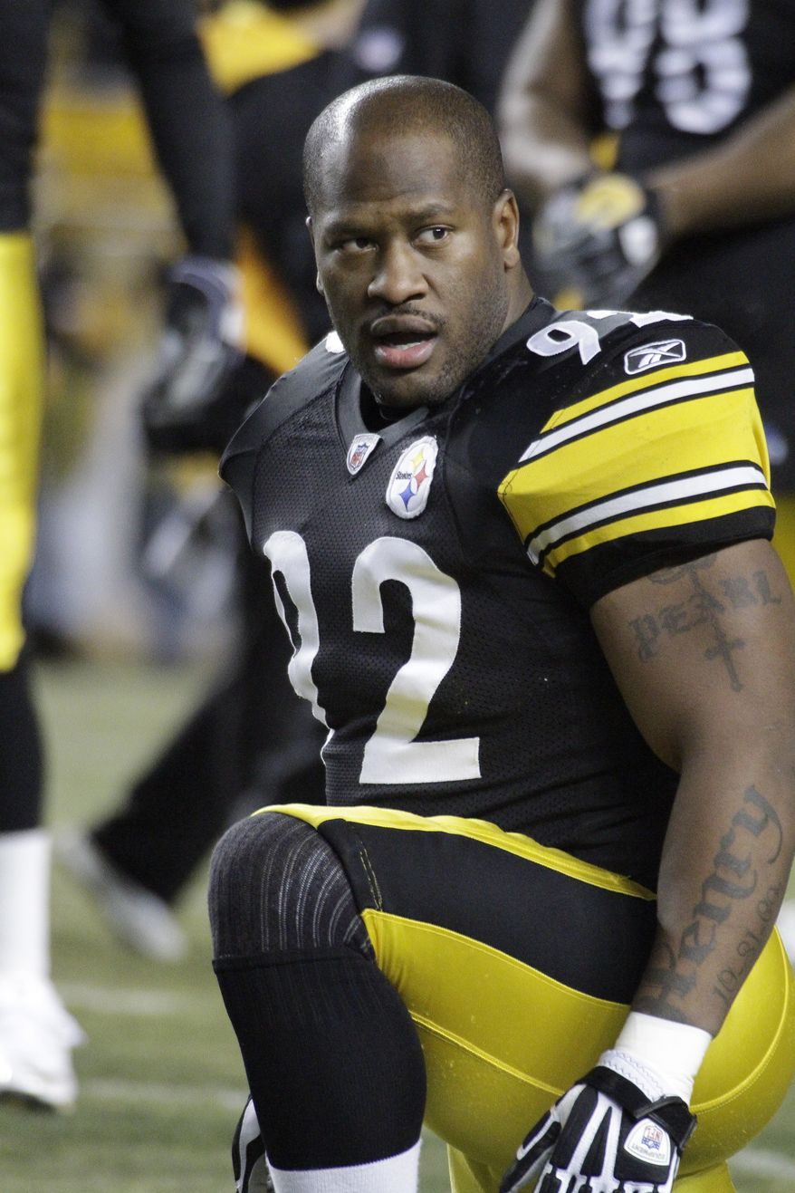 """Pittsburgh Steelers linebacker James Harrison (92) warms up before an NFL football game against the Carolina Panthers in Pittsburgh, in this Dec. 23, 2010 file photo. Heavily fined Pittsburgh Steelers linebacker James Harrison calls NFL Commissioner Roger Goodell a """"crook"""" and a """"devil,"""" among other insults, in a magazine article in the August issue of Men's Journal. (AP Photo/Gene J. Puskar, File)"""