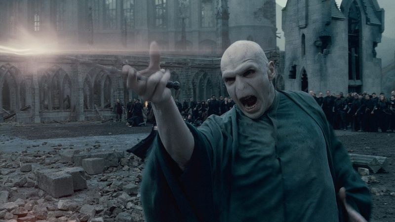The great victory in the series is not that the three young wizards finally got a chance to defeat Voldemort (seen here, played by Ralph Fiennes) but that viewers got to watch them grow up. (Warner Bros. Pictures via Associated Press)