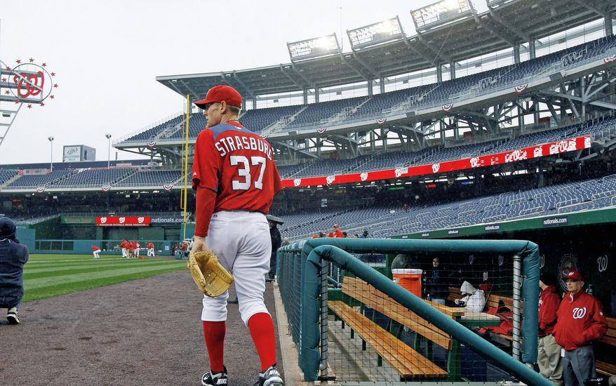 Washington Nationals pitcher Stephen Strasburg steps onto the field for practice at Nationals Park on Wednesday, March 30, 2011 in Washington. The Nationals home-opener is scheduled for Thursday against the Atlanta Braves. (AP Photo/Alex Brandon)