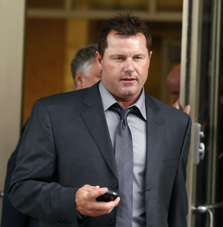 Former Major League Baseball pitcher Roger Clemens leaves federal court in Washington on July 13, 2011, after a day of his trial on charges of lying to Congress in 2008 about using performance-enhancing drugs. (Associated Press)