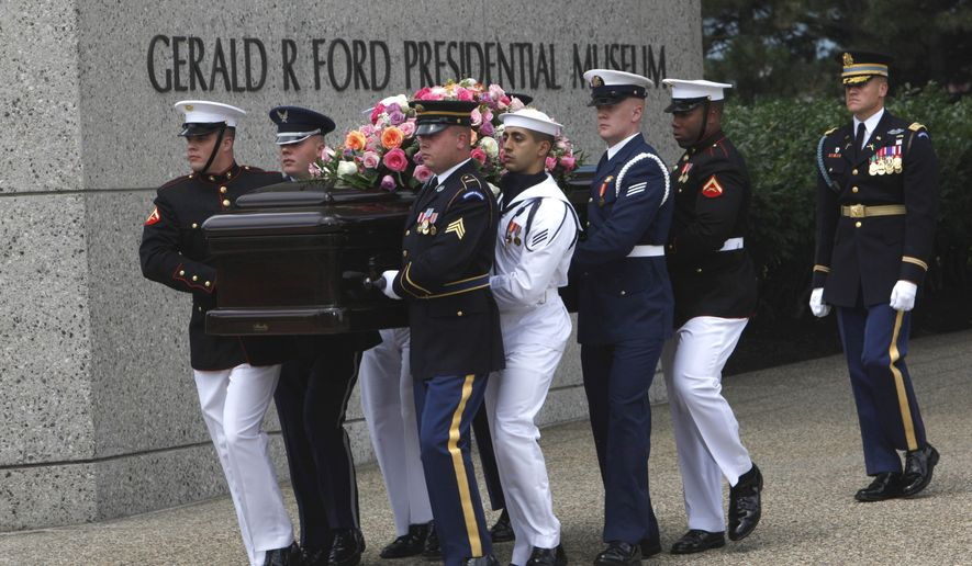 A military honor guard carries the casket of former first lady Betty Ford from the Gerald R. Ford Presidential Museum in Grand Rapids, Mich., on Thursday, July 14, 2011, before funeral services at Grace Episcopal Church. (AP Photo/Paul Sancya)