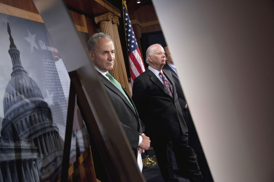 Sen. Charles E. Schumer (left), New York Democrat, and Sen. Benjamin L. Cardin, Maryland Democrat, take part in a news conference about the debt limit on Thursday, July 14, 2011, on Capitol Hill in Washington. (AP Photo/Evan Vucci)