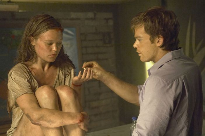 """Michael C. Hall (right) portrays Dexter Morgan and Julia Stiles is Lumen in a scene from the Showtime series """"Dexter,"""" which was nominated for an Emmy for best drama series. Mr. Hall also was nominated for best actor in a drama series. (AP Photo/Showtime, Cliff Lipson)"""
