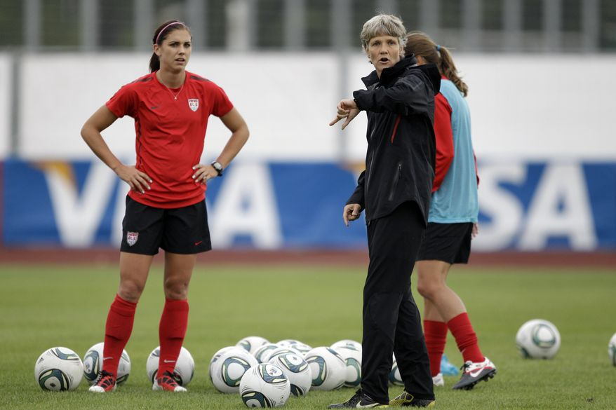 United States head coach Pia Sundhage directs her team as Alex Morgan looks on during a training session in preparation the World Cup final against Japan, which will take place Sunday. (AP Photo/Marcio Jose Sanchez)