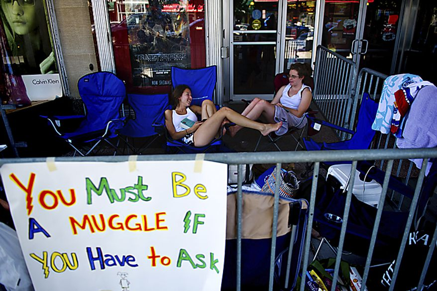 "Camping out starting at 2 pm Wednesday, Maddy Feller, 18, left, and Shannon O'Reilly, 14, both of the District, were the first ones to get in line for the midnight start of the final Harry Potter movie, near the Uptown Theater along Connecticut Ave. in Cleveland Park, in Washington, D.C., Thursday, July 14, 2011. ""We really wanted to be first and we wanted the best seats,"" said O'Reilly. (Drew Angerer/The Washington Times)"