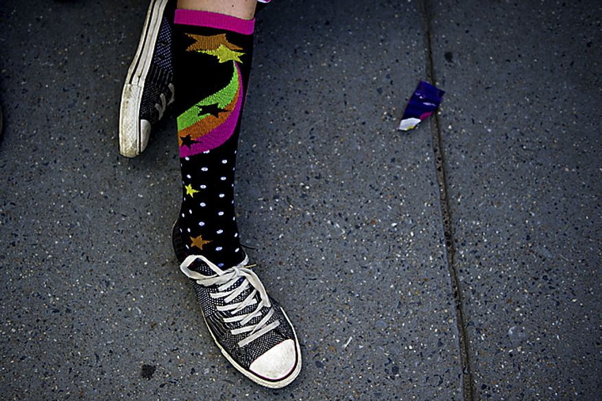 Julia Smith, 14, wears eccentric and colorful socks in the style of the character Luna Lovegood, as she waits for the midnight start of the final Harry Potter movie, near the Uptown Theater along Connecticut Ave. in Cleveland Park, in Washington, D.C., Thursday, July 14, 2011. (Drew Angerer/The Washington Times)