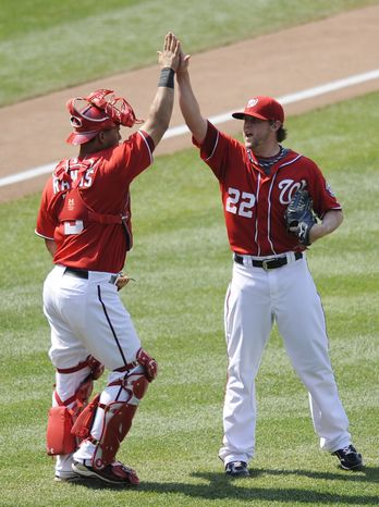 Washington Nationals relief pitcher Drew Storen celebrates with catcher Wilson Ramos after a 2-0 win in a baseball game against the Colorado Rockies on Sunday, July 10, 2011. The Nats are 46-46 entering the second half of