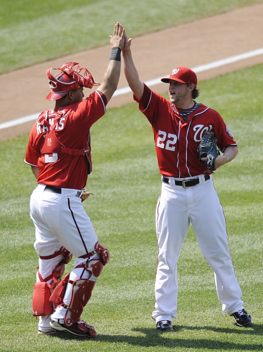 Washington Nationals relief pitcher Drew Storen celebrates with catcher Wilson Ramos after a 2-0 win in a baseball game against the Colorado Rockies on Sunday, July 10, 2011. The Nats are 46-46 entering the second half of the season. (AP Photo/Nick Wass)