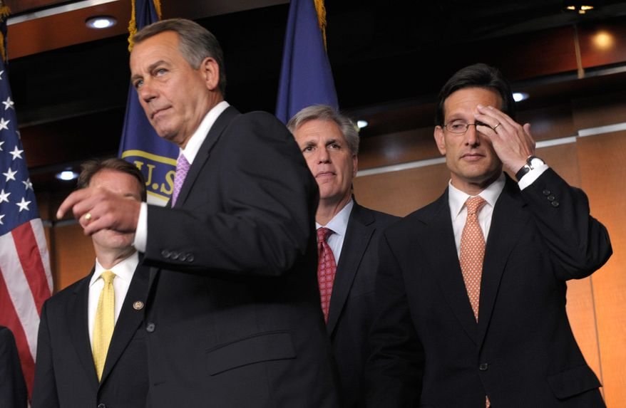 House Speaker John A. Boehner of Ohio (second from left) prepares to speak about the debt ceiling on Capitol Hill on Thursday. House Majority Leader Eric Cantor of Virginia (right) and House Majority Whip Kevin McCarthy of California look on. (Associated Press)