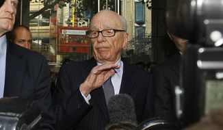 Rupert Murdoch (center) speaks to the media on Friday, July 15, 2011, after meeting with the parents and sister of murdered schoolgirl Milly Dowler in London. (Associated Press)