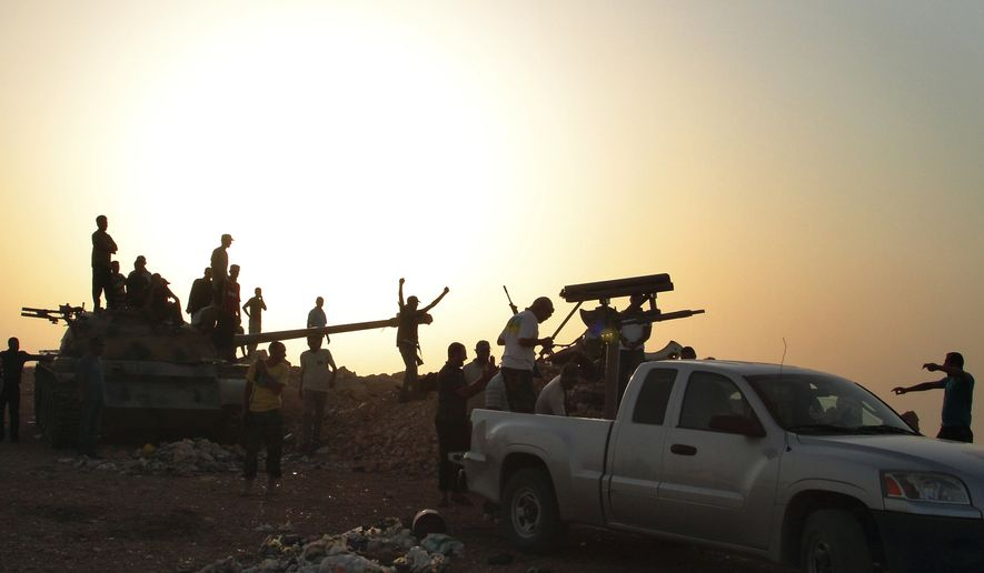 Libyan rebels gather around a captured tank in Kabaw, western Libya, on July 14, 2011. (Associated Press)