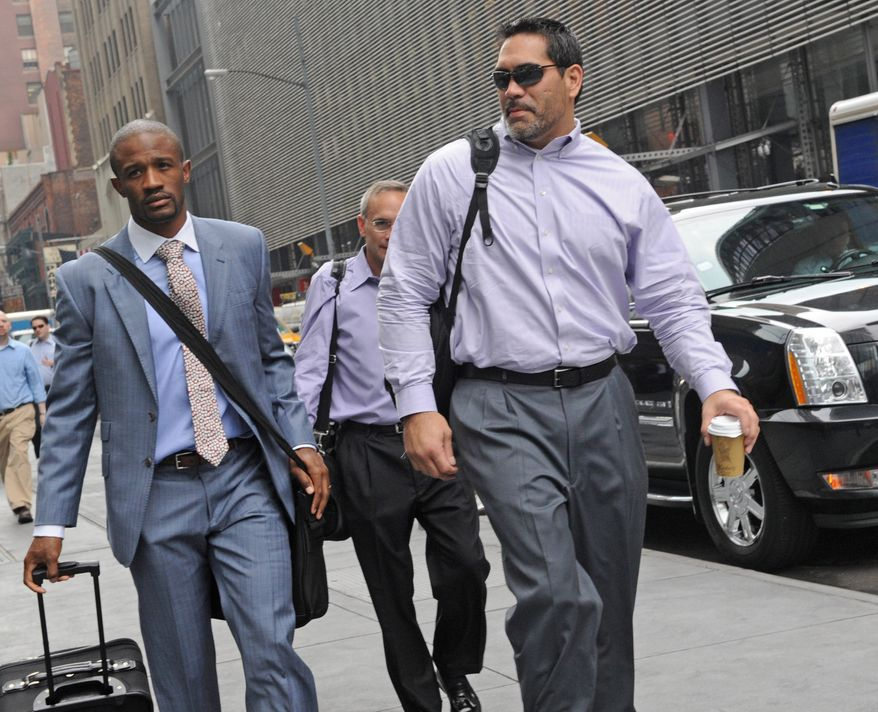 Former Tennessee Titans center and NFL Players Association President Kevin Mowae, right, enters a Manhattan law office, Friday, July 8, 2011, in New York. Members of the NFL Players' Association executive board and owners are meeting in hopes of resolving a lockout that began in March. Baltimore Ravens cornerback Domonique Foxworth is at left. (AP Photo/ Louis Lanzano)